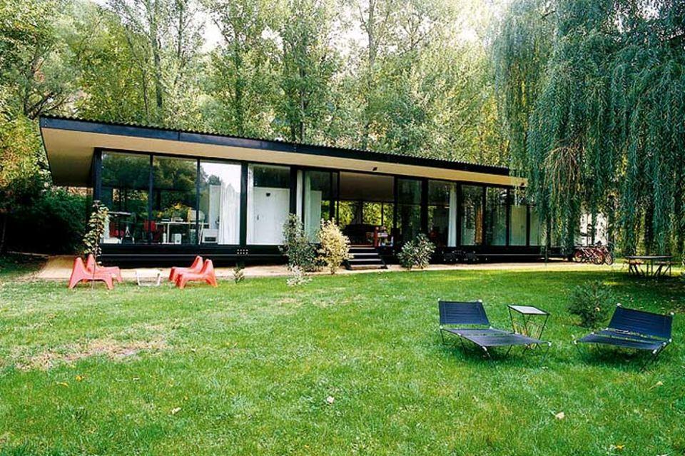 Rundumverglastes Flachdachhaus