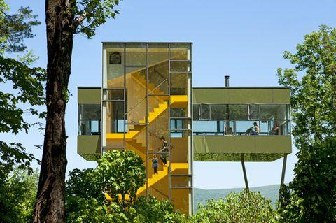 Architektenhäuser: Gläsernes Ferienhaus im Wald