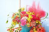 Mit Blumenarrangements kommt der Sommer ins Haus