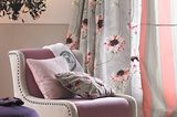 Perfekte Farb- und Musterkombination bei Vorhängen und Kissen