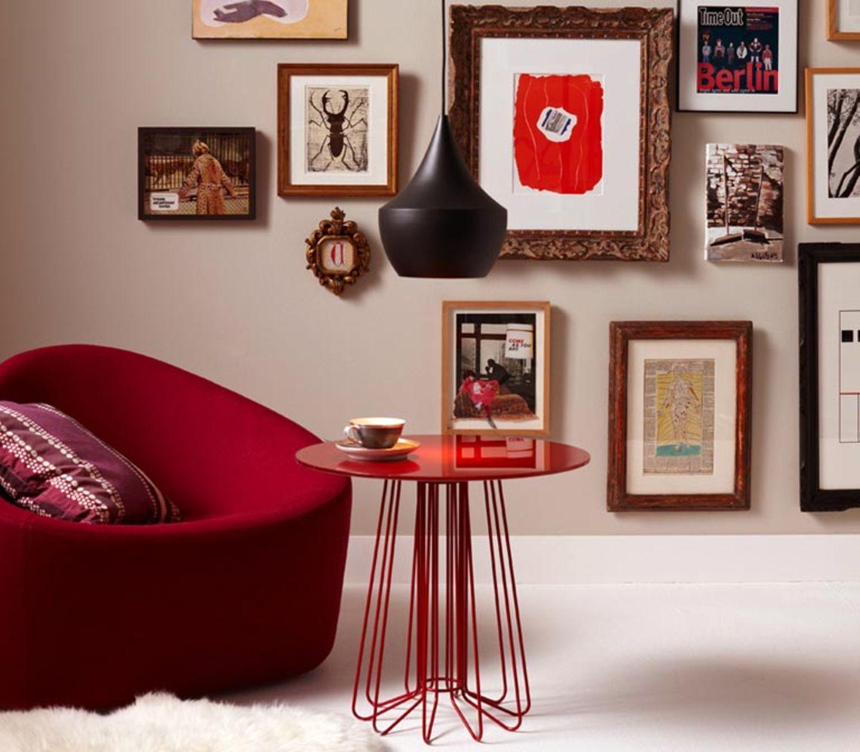 Bildergalerie auf einer Wand in zartem Beige