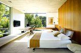 Schlafzimmer mit Holz, Stein und Beton