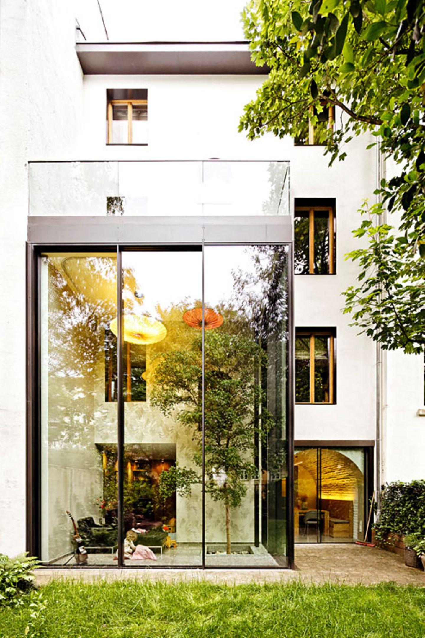 Der Wintergarten öffnet das Haus zur Natur