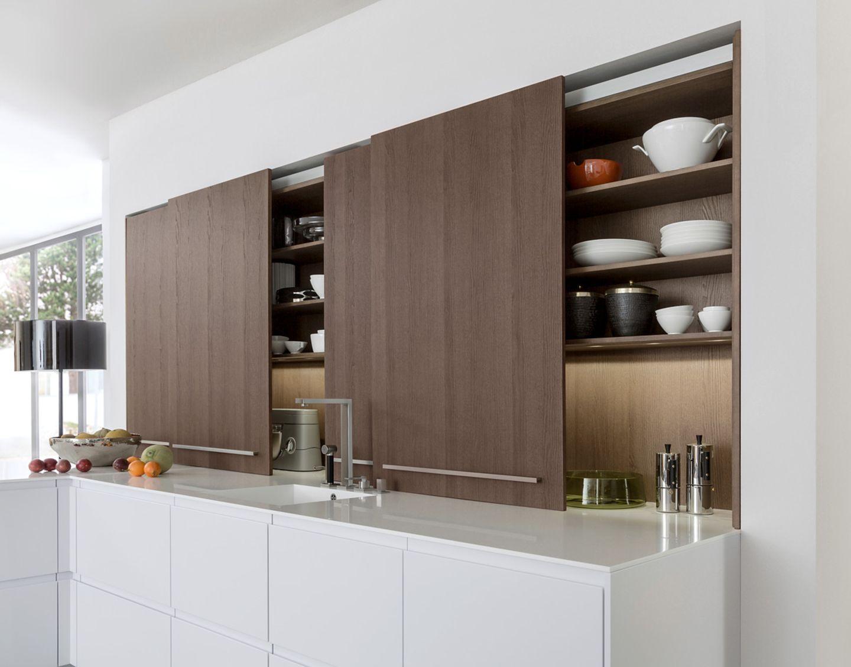 Küchenschränke mit Schiebetüren sorgen für Ordnung