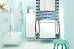 Badezimmer in Lindgrün und Weiß