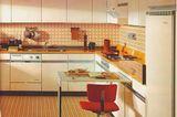 Küche mit orangenem Farbkonzept von Miele, 1969