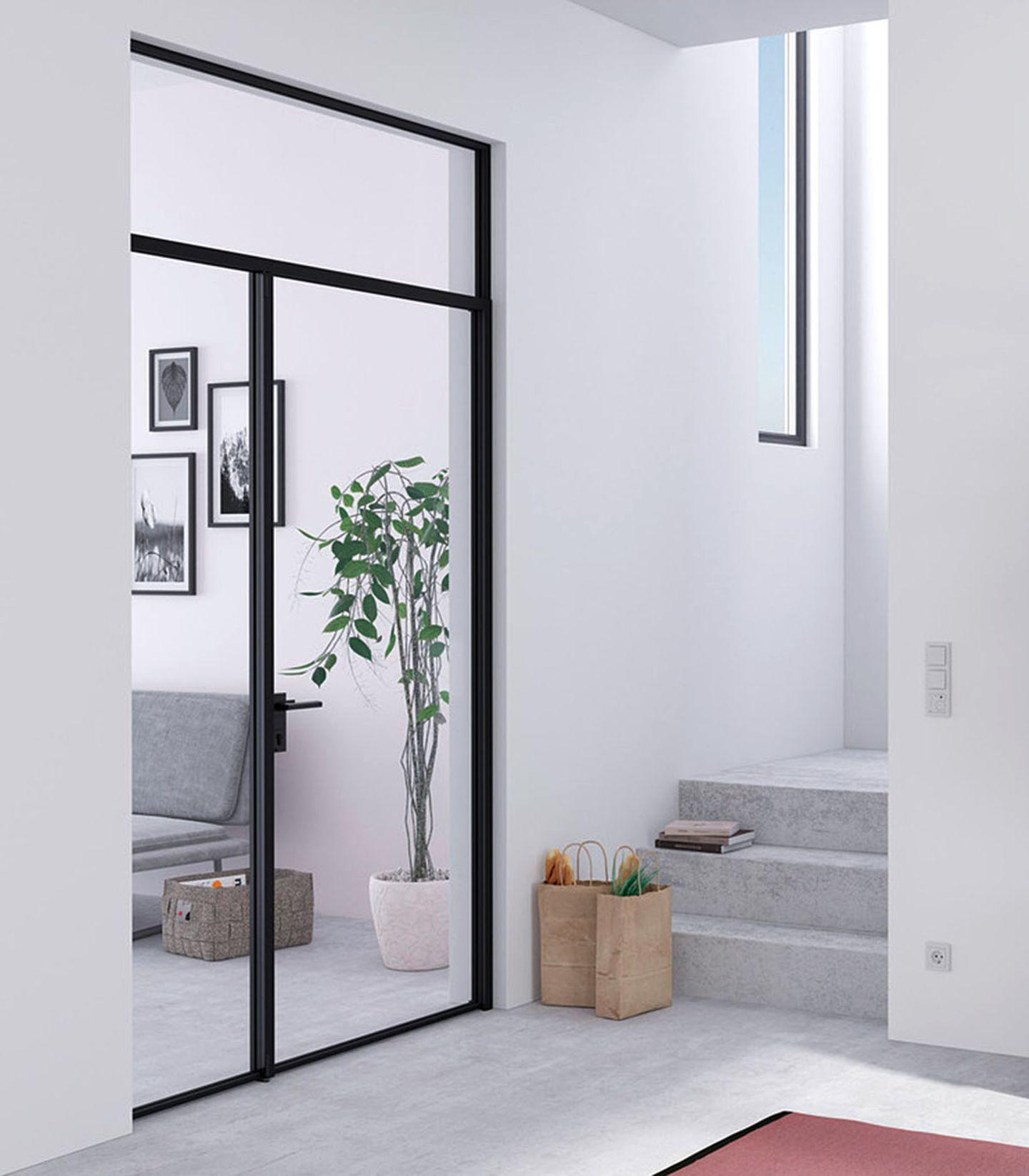 Windfangtür aus Glas und Stahl von Raumplus.