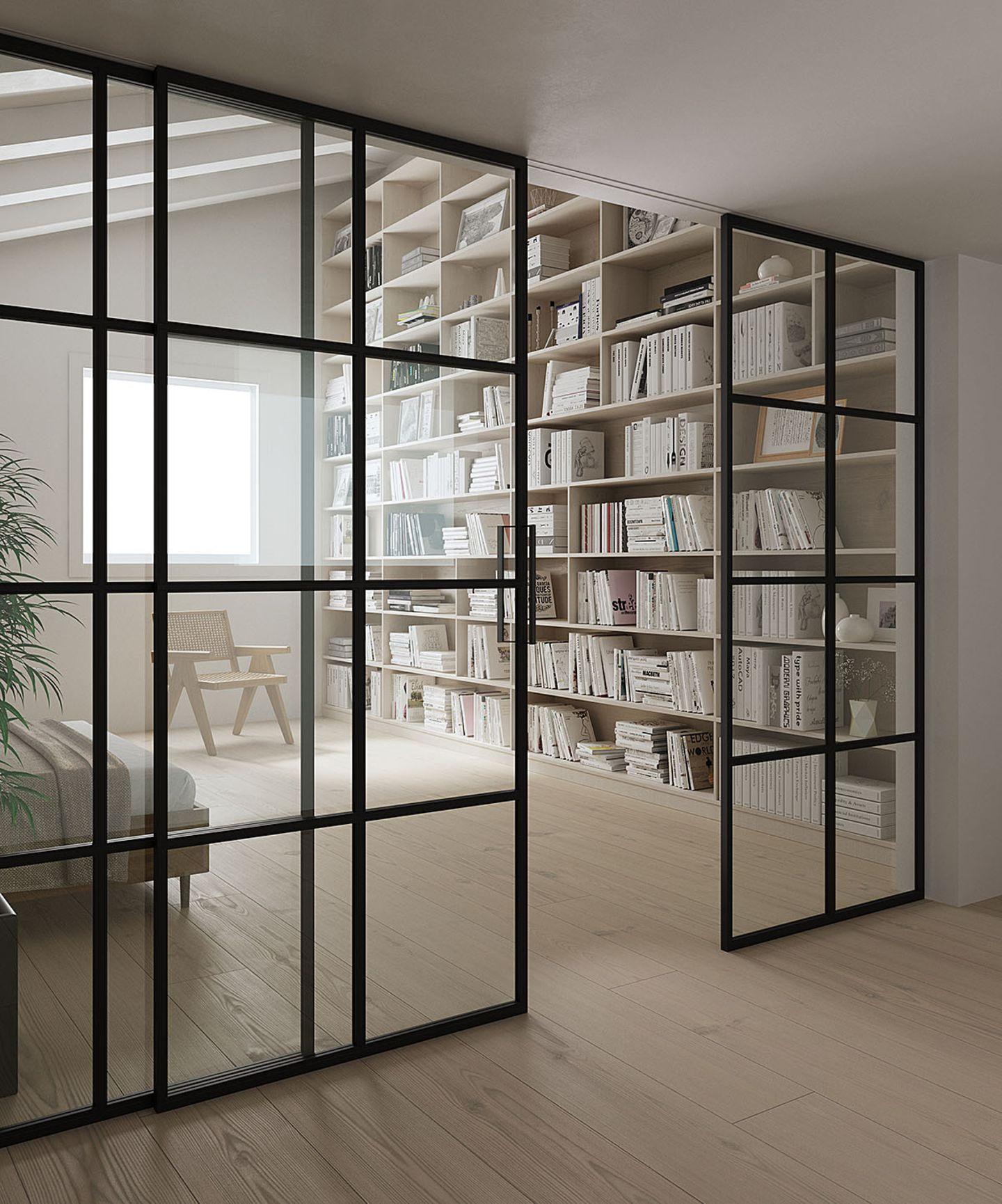 Lofttür aus Glas und Stahl von Holzconnection am Wohnzimmer.