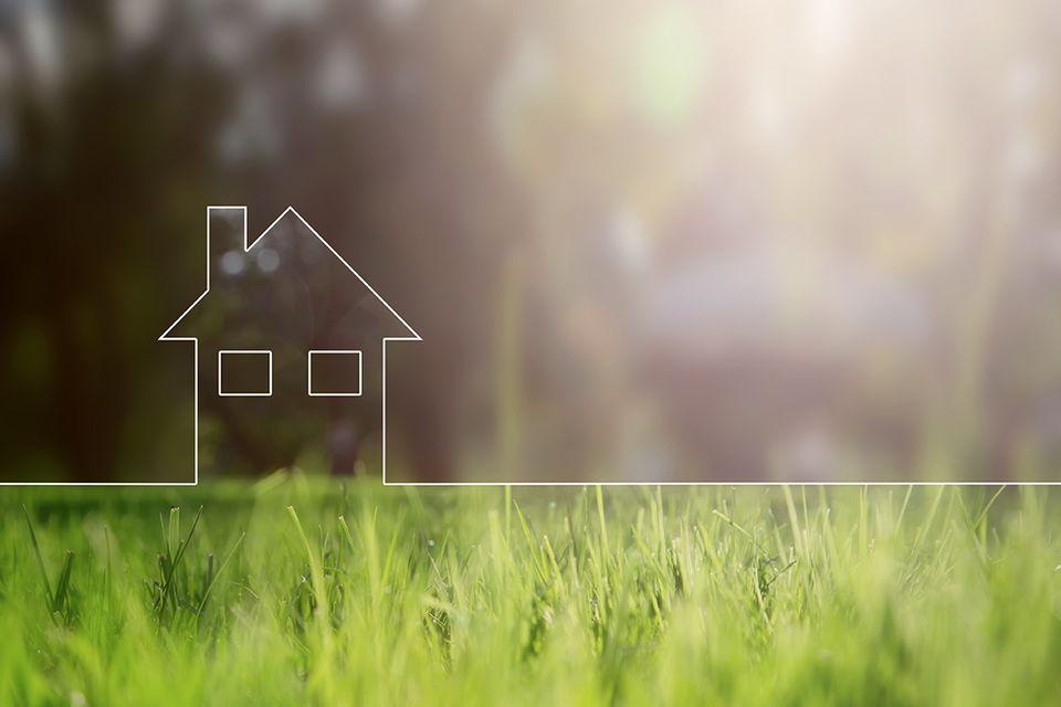Haus Illustration auf einer Wiese.